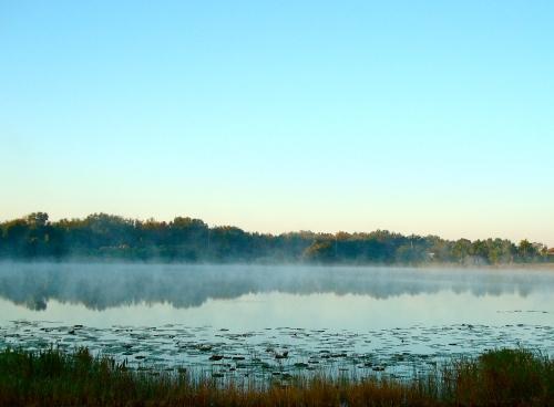 Plumes of steam fog dance across the lake.
